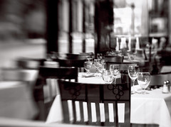 Lets Have Lunch (LornaTaylor) Tags: aplusphoto traffic summer street reflections people lensbaby lensbabies closeup composer blackandwhite artworks abstract streetphotography bokeh bw lornataylor taylorimagesca table restaurant chairs wineglasses placesetting window