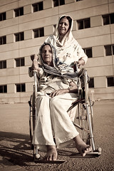 Generations (| HD |) Tags: world pakistan portrait woman 20d female canon who wheelchair daughter mother health hd organization darwish hamad tb tuberculosis