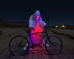 Flat tire (Nocturnal Bob) Tags: longexposure blue red sculpture lightpainting bicycle night urbandecay nevada ghost ghosttown moonlight flattire rhyolite ruraldecay ghostrider goldwellopenairmuseum explored albertszukalski
