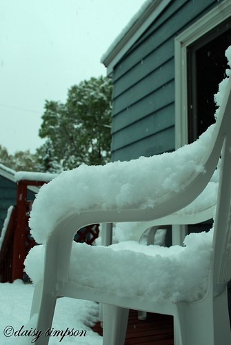 snow covered patio chair