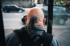 I don't even know what this hairstyle is called? Is it a bald-mullet? A fat pony-tail? A squid? (deepstoat) Tags: street colour london film zeiss 35mm yashicat5 autaut deepstoat