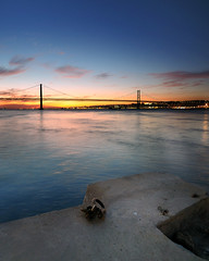 Tied to your light (CResende) Tags: bridge sunset portugal river nikon lisboa ponte tejo ponte25deabril 25deabril cais d90 sigma1020 photowalker hitechfilters cresende