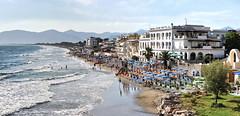 Panorama_Sperlonga (christianisthedj) Tags: summer italy panorama beach water landscape hotel sand surf italia wave parasol aurora sperlonga