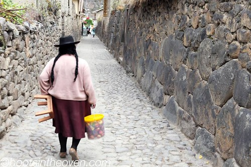Inca wall, lady, apples