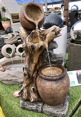 Trickling Water (Dano-Photography) Tags: iphone7plus amateur candid water h2o rain feature garden bowl tree stump fountain peaceful tranquil autumn spring summer dano iphone bubbling highlands scottish scotland jug trickling resin polyester jugs beach 2017