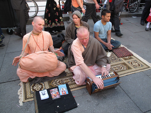 Hare Krishna worked hard to be heard over the sound of the indians.
