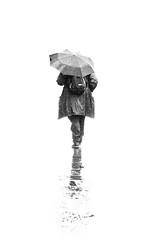 Another lovely summer. (Ian McWilliams.) Tags: summer blackandwhite white wet rain umbrella walk coat explore highkey newcastleupontyne macaz1977 peopleography anotherlovelysummer macaz1977portfolio