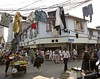 Classic Shanghai_Luwan District_W2A1266 (Big Red Studio) Tags: street corner shopping walking shanghai tricycle neighborhood clothes mobilephone vendor shanghaiist selling pajamas telephonewires oldshanghai