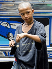 Manila, Philippines - A Multi Taskers (Mio Cade) Tags: street travel boy brazil portrait bw white black brasil kids photography kid child drink coconut brother philippines documentary social manila murder seller roney streetkid claudiney pedicap