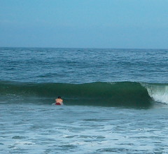 Pat is dwarfed by a wave, prompting his emergence shortly after