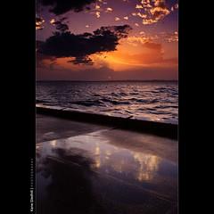 Cloud Dancing. ([ Kane ]) Tags: ocean sunset sun water clouds reflections orb australia brisbane qld queensland rays kane wellingtonpoint gledhill 50d kanegledhill wwwhumanhabitscomau kanegledhillphotography