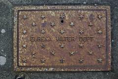 Eureka Water Dept (Jackal of all trades) Tags: texture water humboldt pavement plate weathered access tamron eureka dept eurekaca tamron2875mmf28 pentaxk10d