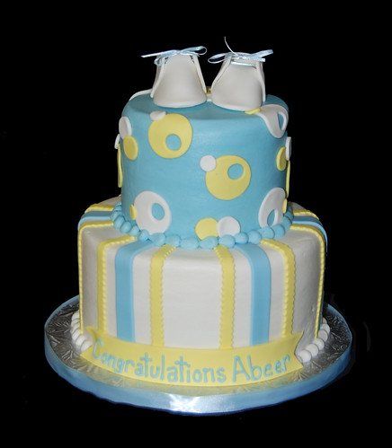 Blue and Yellow 2 tier baby shower cake with baby booties , originally ...