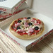 Miniature Pizza With Ham and Olives