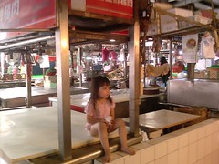 Christina sitting in the market