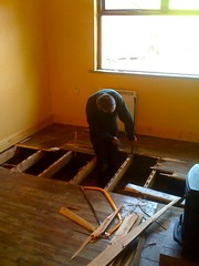Tom removing the sitting room floor