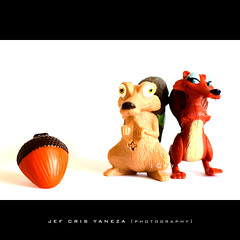 Temptation (jef cris) Tags: animals iceage toys blog crazy saturated funny naturallight whitebackground blogged highkey temptation mcdonald manfrottotripod canon50mmf14lens grouptripod krayzeetoosday iceage3dawnofthedinosaurs choisephotos tripoded