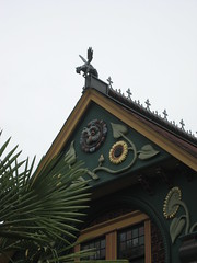 Nob Hill House (AGA~mum) Tags: palmtree sunflowers turret griffin carvings paintedlady victorianhome ornategates latinphrase leadwindows queenannehillseattle owlcarving nobhillinseattle roofridges