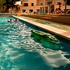 The Smile of the Crocodile (Loco Cocodrilo) (Gilderic Photography) Tags: light boy summer vacation sun game reflection green water pool childhood swimming children toy island hotel islands soleil kid spain funny europe raw afternoon child humor perspective ile humour ombre panasonic cocodrilo espana inflatable lumiere crocodile gag enfants mallorca espagne piscine ete majorca baleares lightroom iles lumic garcon croco gonflable majorque lx3 dmclx3