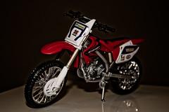 Mini Moto (Gustavo Bresolin) Tags: macro canon brinquedo close sl moto 1855mm rs riograndedosul pneu xsi motocicleta soleopoldo motoca 450d soleo