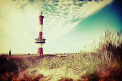 lighthouse (besimo) Tags: summer sky sun moon lighthouse grass lensbaby clouds photoshop island holga lomo sand crossprocessing 20mm wangerooge besimmazhiqi levelandtap