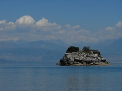 another treasure island (miradel) Tags: blue white lake mountains water mystery clouds island rocks day alone treasure sunny another montenegro faraway balcans jezero balcan itstime skadarsko skadar   skadarlake