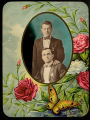 Two men in suits with bowties (George Eastman House) Tags: flowers 1920s portrait men altered formalwear medallion oval georgeeastmanhouse geh:maker=unidentifiedphotographer geh:accession=200805020009 geh:medium=gelatinsilverprintpopwithappliedcolorandhalftonephotoengravingprintmountedoncelluloidplaque