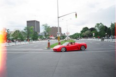 "Ottawa Ferrari Fest 2009, ""Lomo"" film shots: A Ferrari 360 Spider. (Steve Brandon) Tags: auto show city people ontario canada motion film car speed geotagged spider moving lomo lomography automobile display corsoitalia ottawa 360 ferrari voiture spyder lightleak motionblur pedestrians overexposed modena littleitaly  ville hairpin sportscar fca barchetta redcar f360 exoticcar   filmphotography italiancar   fixedlens prestonstreet  ferrari360spider redcarnation cheaplens   filmphoto 35mmcamera ferrari360modena  ferrari360spyder  ferrari360modenaspider carlingavenue   ferrariclubofamerica ferrari360modenaspyder fujidl8 champagneavenue demonstrationzone 360 360 360"