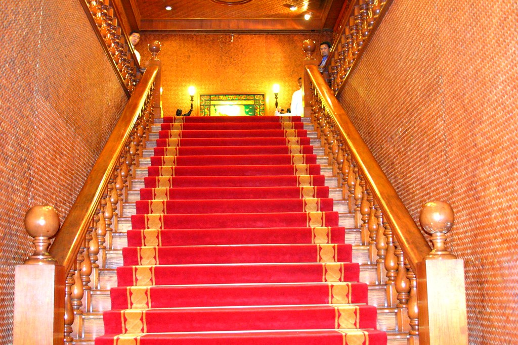 The carpeted stairs leading to the Gallery of Presidents which one has to pass to get to the Rizal Hall.