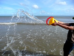 Splash! (Tasmin_Bahia) Tags: blue red sky wet water yellow clouds droplets bucket sand waves peaceful bubbles splash