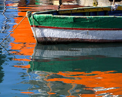 Reflections (Sandra Leidholdt off a bit) Tags: port reflections boats bay harbor boat seaside fishing colorful europe mediterranean barca european harbour malta bateaux explore anchorage fishingboats frontpage reflexos reflets fishingvillage reflejos reflexionen marsa mditerrane marsaxlokk riflessioni explored sandraleidholdt xlokk leidholdt sandyleidholdt bayofthesirocco