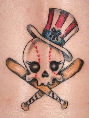 baseball tattoo. lower back