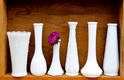 Tall white milk glass vases in wood shadowbox, via Flickr: The Sunday Times Market