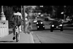 Spring Cruisin' (Dom Cruz) Tags: street people blackandwhite bw woman ontario canada girl bike bicycle canon cycling spring downtown dof traffic bokeh candid guelph streetphotography cruising sunny biking biker cruiser lateafternoon f20 135l beachcruiser canonef135mmf2lusm gordonstreetbridge 40d canoneos40d