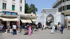 Day in The Life in Tangier (cwgoodroe) Tags: ocean africa street old city sea summer people sun fish bus colors metal ferry plane children cafe sand ancient colorful doors artistic pentax vibrant muslim poor hijab streetlife mosque arabic panasonic doorway morocco arab friendly moors conservative script casbah vegtable merchants continent merchant christians tangier monger moroccan tanger kasbah cleric sadfaces metaldoors fishmerchant casba casbha dailylifeportrait