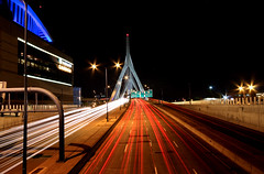 Zakim Traffic Trails Retake (Amar Raavi) Tags: city longexposure bridge sunset boston night canon highway nightshot traffic unitedstates massachusetts charlesriver newengland sigma wideangle freeway charlestown lighttrails bigdig suspensionbridge bostongarden northend amar beantown zakimbridge bostonist traffictrails i93 bunkerhillbridge centralartery sigma1020mm leonardpzakim cablestayedbridge leonardpzakimbunkerhillmemorialbridge interstate93 tdgarden raavi canoneos40d tdnorthbankgarden amarraavi zakimbunkethillmemorialbridge