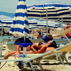 Comfortable Chair - Man (Osvaldo_Zoom) Tags: summer italy beach comfortable seaside chair bravo couple chairman umbrellas calabria sunbathing