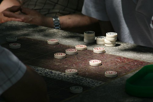 Men playing games in Columbus Park, downtown Manhattan.