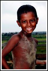 Smile (Tipu Kibria~~BUSY~~) Tags: boy portrait people cute smile face childhood canon eos kid child innocent lifestyle dhaka bangladesh canonefs1785mmisusm xti mohammadpur 400d shudhuibanglamohammadpurvromon