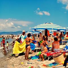 Moroccan Beach Pedlar (Osvaldo_Zoom) Tags: summer people italy beach colors seaside bravo tan explore frontpage colori calabria moroccan pedlar
