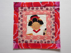 Red (BrianinLR) Tags: pink red floral girl square japanese shoes quilt tomatoes logcabin clogs blocks bekah borders kaffefassett woodenshoes jaymccarroll alexanderhenry lovetomatoes smilesaroundtheworld