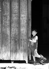 Something's missing (Anna_Fischer) Tags: door wood boy bw childhood kid havana cuba pb skate porta rollerblade criana habana menino