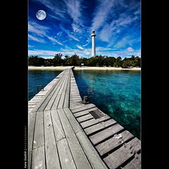 Circles and Lines - Le Phare Amedee Lighthouse ([ Kane ]) Tags: ocean blue sky lighthouse green water clouds french island pier ladder kane newcaledonia noumea napoleoniii gledhill 50d tropicial lighthouseisland kanegledhill secondhighestlighthouseintheworld wwwhumanhabitscomau kanegledhillphotography