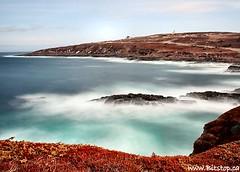 Cape Spear Waves (Karen_Chappell) Tags: ocean longexposure blue sea lighthouse seascape canada water newfoundland landscape geotagged coast scenery waves scenic rocky atlantic filter shore coastline rugged nfld eastcoast capespear eastcoasttrail nd110 geo:lat=47522048 geo:lon=52634897
