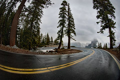 Yosemite Glacier Point Curve With Half Dome in Stormy Winter Horizon (Greg - AdventuresofaGoodMan.com) Tags: california road ca usa fog america turn forest nationalpark bend pavement gray fisheye yosemite halfdome redwoods curve glacierpoint nikond80 greggoodman powerfulskies