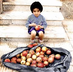 (DeLaRam.) Tags: red house fruit child sad edited pomegranate explore helpme shahrzad انار بـــــرداشـــــتآزاد