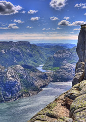 Cliffs and Valleys at Preikestolen (Jim Boud) Tags: ocean sky cliff mountain norway clouds digital canon eos rebel norge hike atlantic fjord soe hdr xsi topaz preikestolen prekestolen lysefjorden norse adjust pulpitrock 450d forsand jimboud jrbxom jamesboud jamesboudphotoart gettyvacation2010