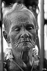 woman praying.... (MalNino) Tags: travel bw cebu 2008 magellanscross traveler nikon200 nikkor2870mmf28