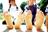 IS078-004 (madrox21) Tags: girls 2 summer people feet childhood smiling youth children outdoors sitting seasons barefoot whites resting braids females pigtails relaxation hairstyle carefree facialexpression