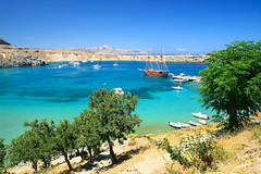 Lindos (esther**) Tags: flowers blue trees sea summer vacation sky sun beach nature water beautiful sunshine landscape boats happy holidays sailing view sunny greece rhodes interestingness11 summerdays lindos bluesea interestingness8 interestingness200